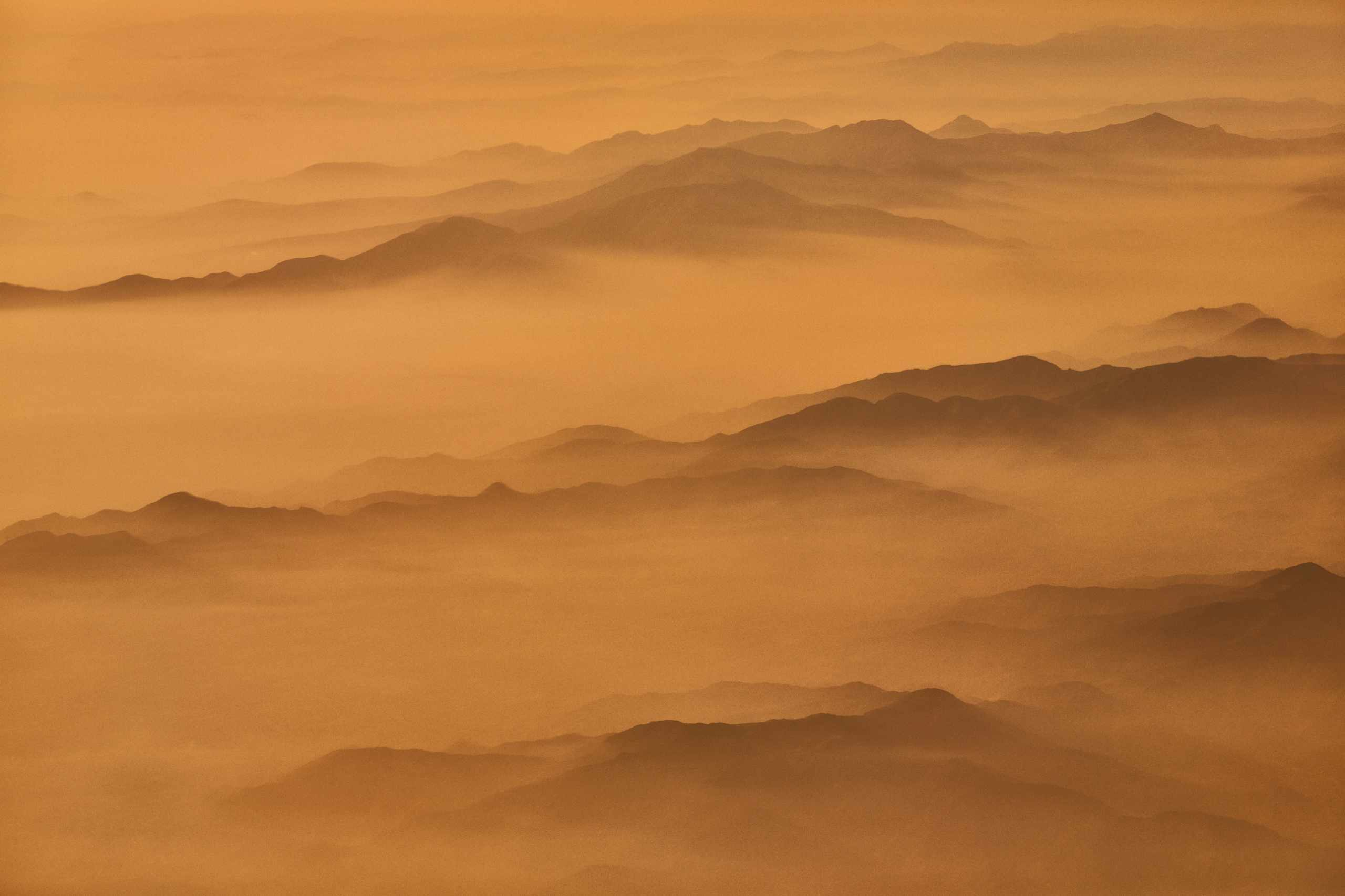 The Andes fading into misty sunset
